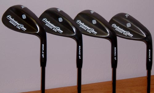 golf - Set of four wedges in lofts of 52, 56, 60 and 64. Black set of wedges. semi U groove